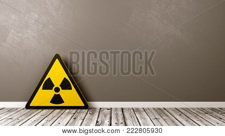 Ionizing Radiation Hazard Symbol on Wooden Floor Against Grey Wall with Copyspace 3D Illustration
