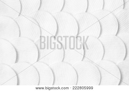 Cotton pads pattern. White abstract background. Flat lay. Beauty, spa, body care.