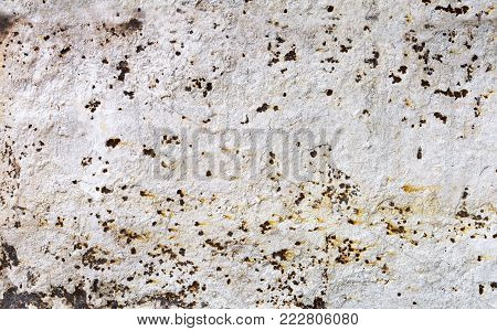 Old rusted metal sheet. Rusty surface caused by oxidation iron with white cracked color. For design work texture and background.