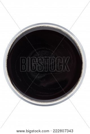 Glass of dark stout beer top view with foamon white background