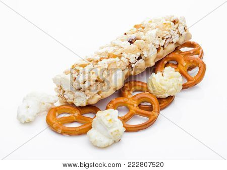 Popcorn protein cereal energy bar with pretzel on white background