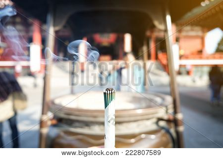 Close up burning Japanese incense sticks at Famous Buddhist temple Senso-ji in Asakusa, Japan