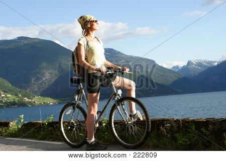 Sporty Woman On A Bicycle Trip In The Mountains 2