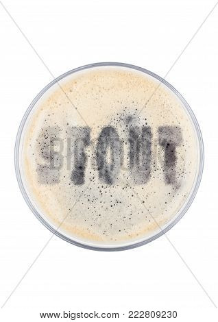 Glass of stout beer top with letters shape on white background top view