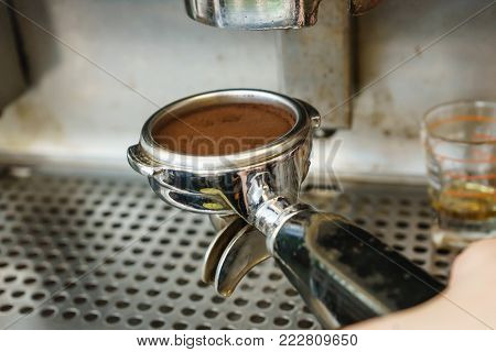 Barista Barister makes coffees in coffee bar.espresso preparation in coffee machine.Hands bartender cooking coffee, Interior bar, bartender, shallow depth of field.Coffee grinder