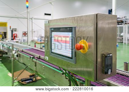 Control board for industrial machines. Controller machine box display. Foreground of control panel in a food and beverage processing plant. Modern industries.