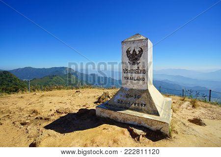 Milestone post on Phu Chi Fa in Chiang Rai, Thailand.
