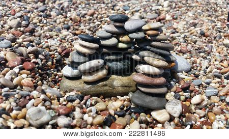 a beautiful concept with multicoloured pebbles on the seashore.