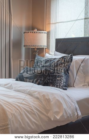 Single Bedroom With Set Of Pillows On Bed