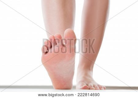 Feet care concept, female foot, chiropody isolated on white background, studio shot