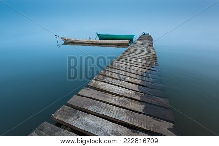 Meditative Landscape With Old Wooden Pier And Wooden Boats, Long Exposure