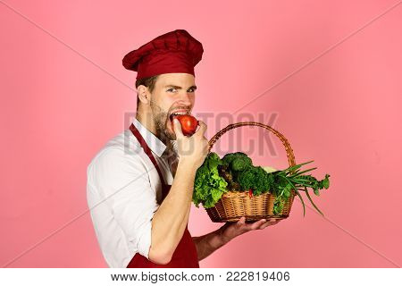 Chef With Strict Face Holds Bunches Of Lettuce On Pink