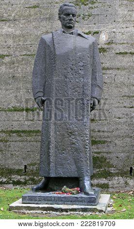Uzice, Serbia - December 16, 2017: statue of Josip Broz Tito behind building of Uzice city museum, Serbia