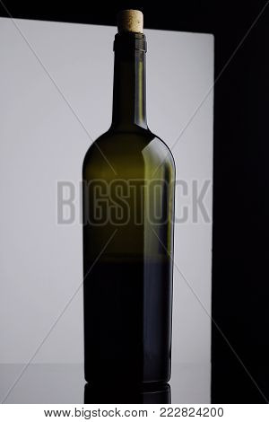 Open Bottle Of Red Wine. Half A Bottle Of Wine. A Bottle Of Wine On A Black And White Background. Bo
