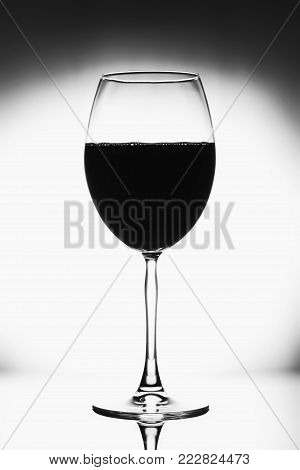 Glass For Wine Black And White Photo With Black Vignette. A Tall Glass With A Thin Stem. The Wine Gl