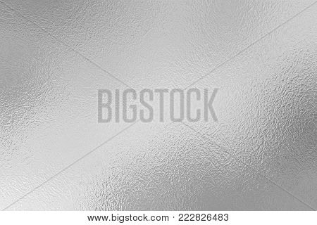 Silver foil decorative texture. Silver metal background