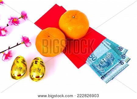 Chinese New Year Background - 50 Ringgit Malaysia in Red Envelope, Mandarin Orange and Gold Ingots with Chinese Character Happiness and Prosperity on white background.