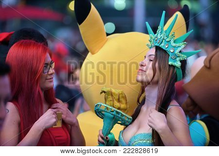 NEW YORK CITY - AUG. 26 : Unidentified people on the Times Square in Manhattan on August 26, 2017 in New York City, NY. Times Square is a major tourist destination and entertainment center.