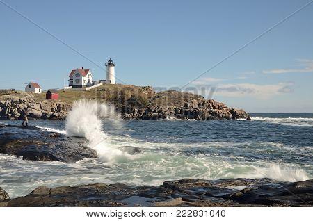 Waves crashing in front of Nubble lighthouse, Cape Neddick Maine