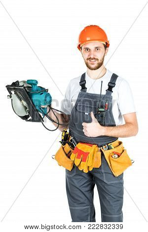 A Builder Or An Employee In A Protective Helmet With An Electric Saw In His Hands. Isolated On White