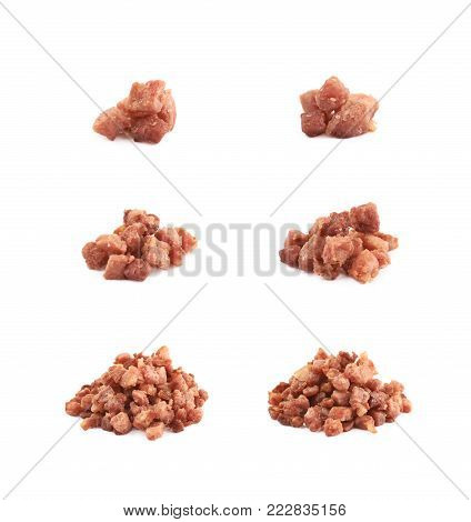 Pile of fried bacon cube bits isolated over the white background, set of six different foreshortenings