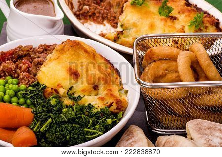 Shepherds Pie topped with Colcannon potato, with a selection of fresh vegetables and Irish Stout battered onion rings and Sourdough Flat Bread.