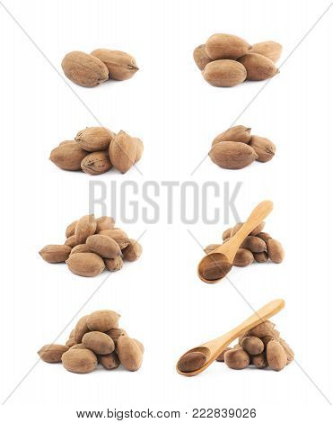 Pile of pecan nuts isolated over the white background, set of eight different foreshortenings