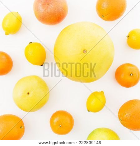 Fruit's background. Lemon, orange, grapefruit, sweetie and pomelo on white background. Flat lay.
