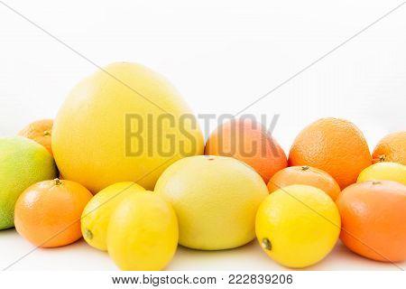 Lemon, orange, grapefruit, sweetie and pomelo isolated on white background. Fruit's background