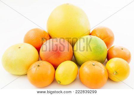 Fruit's background. Citrus fruits - lemon, orange, grapefruit, sweetie and pomelo isolated on white background.
