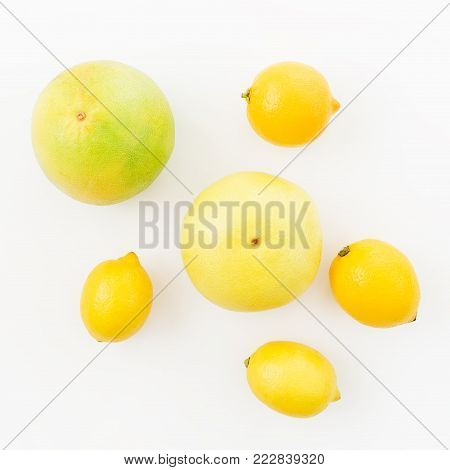 Fruits pattern with lemon, sweetie and pomelo isolated on white background. Flat lay, top view. Fruit background