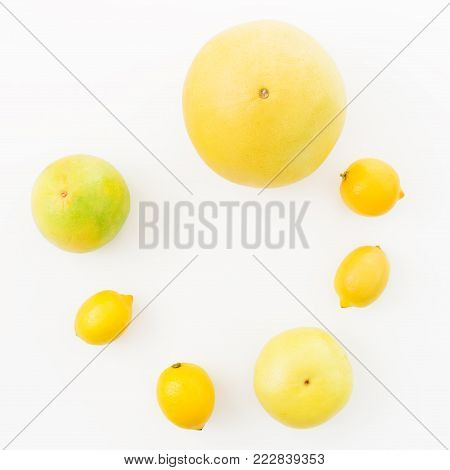Citrus fruits frame of lemon, sweetie and pomelo on white background. Flat lay, top view. Fruit's background