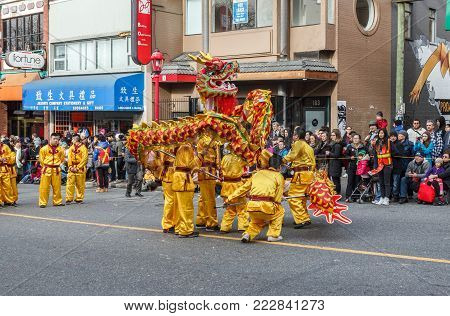 VANCOUVER, CANADA - February 2, 2014: People playing dragon dance for Chinese New Year in Chinatown