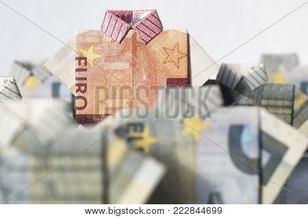 Be a leader concept: euro banknotes folded like a t-shirt