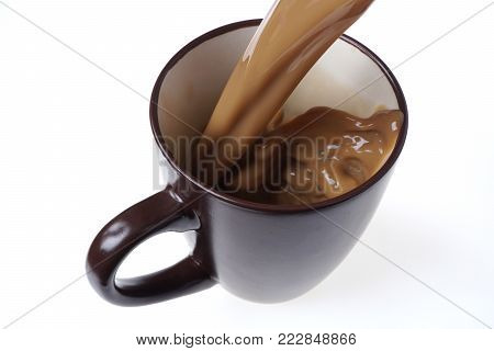 Pouring Home Made Coffee Into A Cup. Café Latte