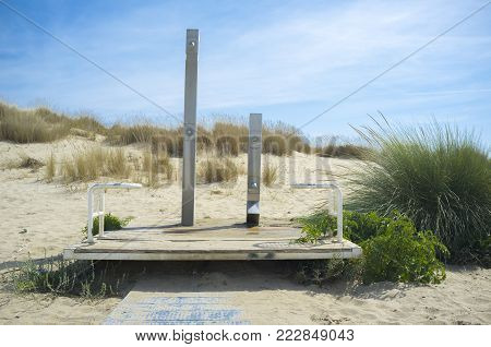 Showers at the entrance to the beach near Huelva, Spain. There are two different height, one for adult and one for chidren