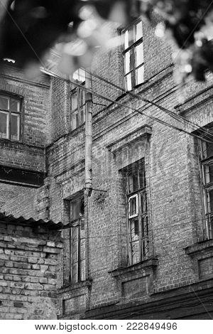 The building of the old psychiatric asylum in Kharkiv, Ukraine; old film effect