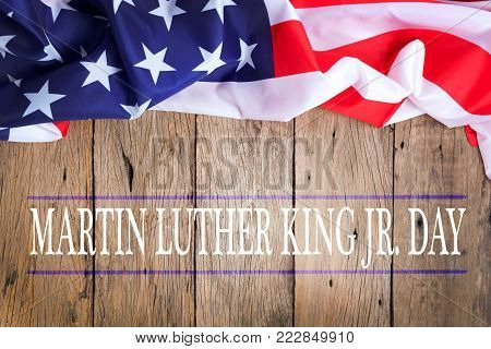 Happy martin luther king jr. day background with american flags on old wood background
