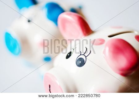 economy and finance - savings in a money box - three white  piggy banks on white background