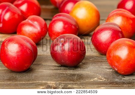 Ripe plum fruit (Julee) on wooden background, healthy fruit