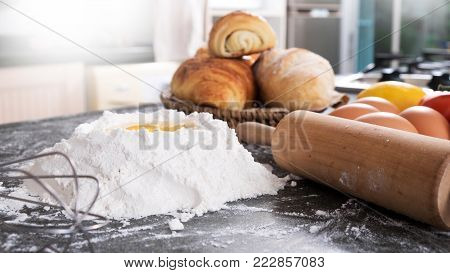 Woman's hands knead dough with flour, eggs and ingredients. at kitchen