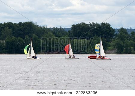 Sailing yacht race. Team athletes participating in the sailing competition. Sailboat. Recreational Water Sports, Extreme Sport Action. Healthy Active Lifestyle. Summer