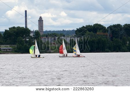Sailing boat yacht or sailboat group regatta race on sea or ocean water. Panoramic view