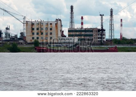 Cargo ship for sea transport.Large cargo ship.Large cargo ships parked in the river.Transshipment vessel