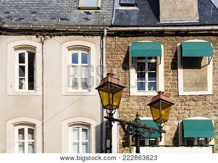 travel to France - facades of urban houses in Boulogne-sur-Mer city on square Place Godefroy de Bouillon in summer day