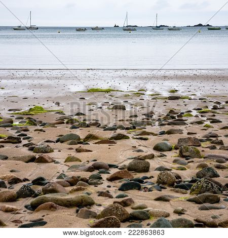 travel to France- beach Plage de la Baie de Launay in Ploubazlanec commune in the Cotes-d'Armor department in Brittany in summer evening