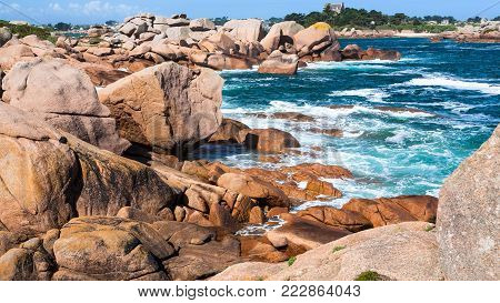 travel to France - rocky shore of English Channel in Ploumanac'h site of Perros-Guirec commune on Pink Granite Coast of Cotes-d'Armor department in the north of Brittany in sunny summer day