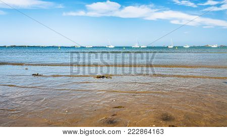 travel to France - view of on bay Anse de Launay from beach Plage de la Baie de Launay of English Channel in Paimpol region of Cotes-d'Armor department of Brittany in sunny summer day