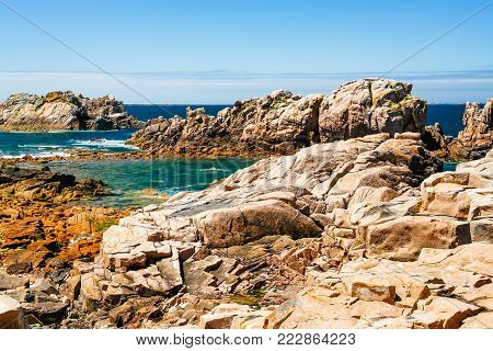 travel to France - rocky coasline of Ile-de-Brehat island in Cotes-d'Armor department of Brittany in summer sunny day