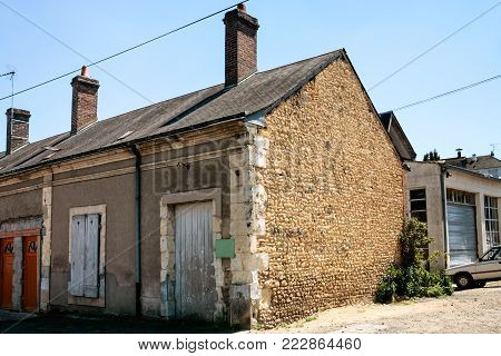 travel to France - old garage on the outskirts of the city
